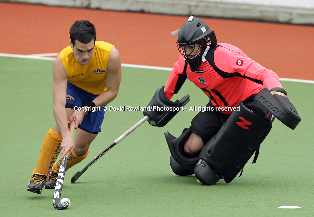 Southern's Nick Ross attempts a penalty shot against Auckland's goalkeeper Devon Manchester in the Ford National Hockey League Final, North Harbour Hockey Stadium, Auckland, New Zealand, Sunday, August 25, 2013. Photo: David Rowland/Photosport