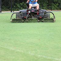 Rickey Gurley Jr. makes one final cut using a reel mower to manicure the grass on the fields.