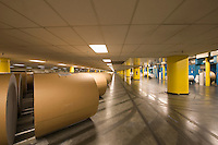 Huge rolls of paper in newspaper factory