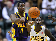Feb. 21, 2012; Indianapolis, IN, USA; New Orleans Hornets small forward Al-Farouq Aminu (0) passes off the ball against the Indiana Pacers at Bankers Life Fieldhouse. Indiana defeated New Orleans 117-108. Mandatory credit: Michael Hickey-US PRESSWIRE