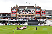 The covers come on early during the Royal London 1 Day Cup match between Surrey County Cricket Club and Kent County Cricket Club at the Kia Oval, Kennington, United Kingdom on 12 May 2017. Photo by Jon Bromley.