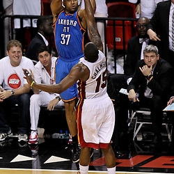 Jun 21, 2012; Miami, FL, USA; Oklahoma City Thunder point guard Derek Fisher (37) shoots over Miami Heat point guard Mario Chalmers (15) during the fourth quarter in game five in the 2012 NBA Finals at the American Airlines Arena. Mandatory Credit: Derick E. Hingle-US PRESSWIRE