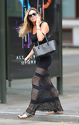 Model Abbey Clancy looking stunning wearing a black maxi dress, sandals and carring Chanel handbag out running errands in London, UK. 25/07/2014<br />BYLINE MUST READ : JAMESY/GOTCHA IMAGES<br /><br />Copyright by &copy; Gotcha Images Ltd. All rights reserved.<br />Usage of this image is conditional upon the acceptance <br />of Gotcha Images Ltd, terms and conditions available at<br />www.gotchaimages.com
