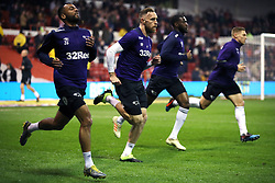 Derby County's (from left to right) Ashley Cole, Richard Keogh, Derby County's Fikayo Tomori and Martyn Waghorn warm up before the Sky Bet Championship match at The City Ground, Nottingham.