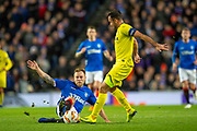 Scott Arfield (#37) of Rangers FC tackles Mario Gaspar (#2) of Villarreal CF during the Europa League group stage match between Rangers FC and Villareal CF at Ibrox, Glasgow, Scotland on 29 November 2018.