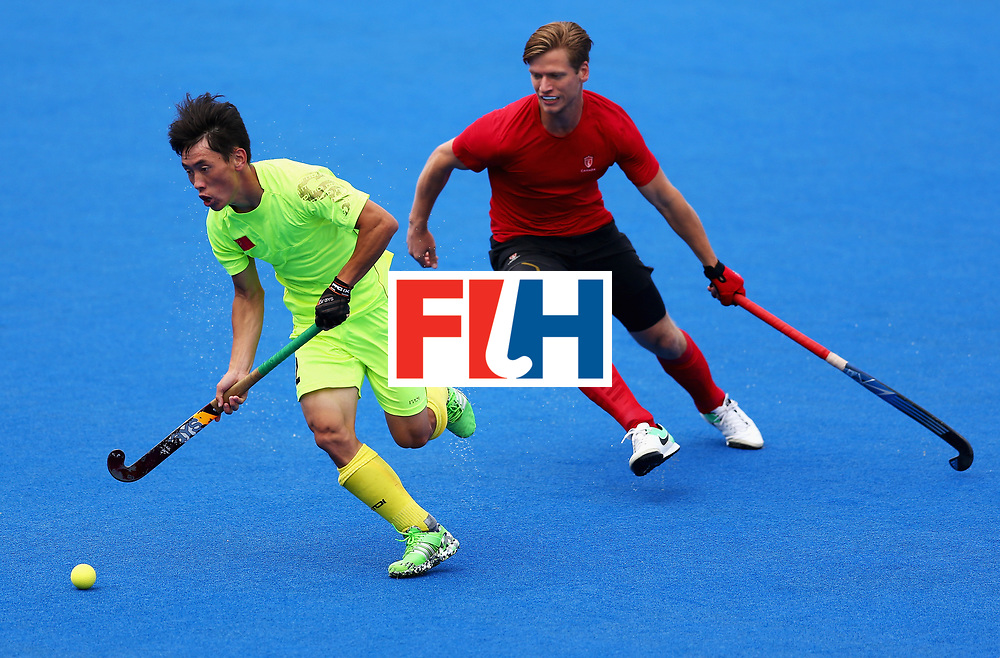 LONDON, ENGLAND - JUNE 24:  Dihao Meng of China takes the ball away from Foris Van Son of Canada during the 5th-8th place match between Canada and China on day eight of the Hero Hockey World League Semi-Final at Lee Valley Hockey and Tennis Centre on June 24, 2017 in London, England.  (Photo by Steve Bardens/Getty Images)