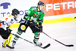 14.11.2014, Hala Tivoli, Ljubljana, SLO, EBEL, HDD Telemach Olimpija Ljubljana vs Dornbirner Eishockey Club, 18. Runde, in picture Miha Pesjak (HDD Telemach Olimpija, #93) vs Robert Lembacher (Dornbirner Eishockey Club, #81) during the Erste Bank Icehockey League 18. Round between HDD Telemach Olimpija Ljubljana and Dornbirner Eishockey Club at the Hala Tivoli, Ljubljana, Slovenia on 2014/11/14. Photo by Matic Klansek Velej / Sportida