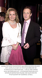 Jockey RICHARD DUNWOODY and MISS GEORGIA BLAKEY, at a  party in London on 23rd April 2002.OZF 68