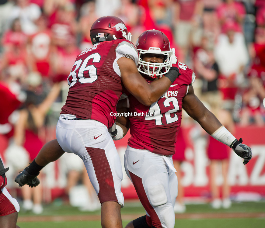 Aug 31, 2013; Fayetteville, AR, USA; Arkansas Razorback defensive end Trey Flowers (86) reacts to a quarterback sack made by defensive end Chris Smith (42) during the second half of a game against the Louisiana Ragin' Cajuns at Donald W. Reynolds Razorback Stadium. Arkansas defeated Louisiana 34-14. Mandatory Credit: Beth Hall-USA TODAY Sports