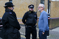 © Licensed to London News Pictures. 04/01/2020. London, UK. Leader of Labour Party, JEREMY CORBYN (R) speaks with police officers at the crime scene in Finsbury Park. Police launch a murder investigation following a death of a man in his 30s on Friday 3 January 2020. Police were called at approximately 6.50pm to reports of a man stabbed and the he was pronounced dead at the scene just after 7.30pm.  Photo credit: Dinendra Haria/LNP