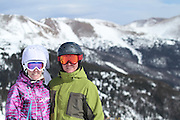 SHOT 2/14/11 12:44:08 PM - Loveland Ski Area in Colorado hosted the 20th Annual Marry Me & Ski Free Mountaintop Matrimony on Valentine's Day Monday, February 14th. The mass wedding ceremony was held at noon at 12,050 feet outside of the Ptarmigan Roost Cabin at Loveland. More than 75 couples were pre-registered to get married or renew their vows high on The Continental Divide in this yearly Loveland tradition.  Following the ceremony couples were invited to a casual reception complete with a champagne toast, wedding cake and music.  (Photo by Marc Piscotty / © 2010)