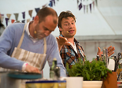 © licensed to London News Pictures. LONDON. UK.  02/07/11. Jamie Oliver giving a cooking demonstration with Johnny Vaughan on day two of Jamie Olivers The Big Feastival on Clapham Common  today (02/07/2011), a three day event featuring food from some of the country's top chefs along with live music.  Photo Credit Ben Cawthra/LNP