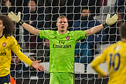 Bernd Leno (GK) (Arsenal) with his arms raised during the Premier League match between West Ham United and Arsenal at the London Stadium, London, England on 9 December 2019.