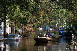 05 Sept  2005. New Orleans, Louisiana. Post hurricane Katrina.<br /> A private search and rescue boat patrols Uptown New Orleans off Napolean Ave following the devastating floods.<br /> Photo; ©Charlie Varley/varleypix.com