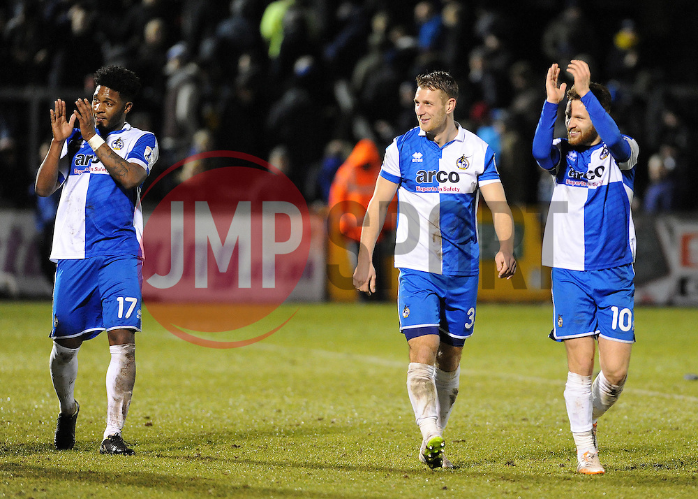 Goal scorers Bristol Rovers' Ellis Harrison (L) and Bristol Rovers' Matty Taylor (R) with Bristol Rovers' Lee Brown (C) applaud the fans - Photo mandatory by-line: Neil Brookman/JMP - Mobile: 07966 386802 - 24/02/2015 - SPORT - Football - Bristol - Memorial Stadium - Bristol Rovers v Braintree - Vanarama Football Conference