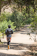 Man Jogging on Trail at Ralph B. Clark Regional Park in Buena Park