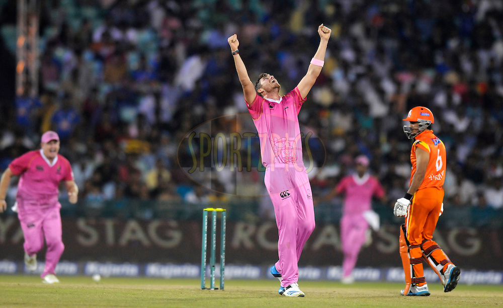 Tim Southee of Northern Districts celebrates the wicket of Umar Siddiq of Lahore Lions during the qualifier 3 match of the Oppo Champions League Twenty20 between the Northern Knights and the Lahore Lions held at the Chhattisgarh International Cricket Stadium, Raipur, India on the 14th September 2014<br /> <br /> Photo by:  Pal Pillai / Sportzpics/ CLT20<br /> <br /> <br /> Image use is subject to the terms and conditions as laid out by the BCCI/ CLT20.  The terms and conditions can be downloaded here:<br /> <br /> http://sportzpics.photoshelter.com/gallery/CLT20-Image-Terms-and-Conditions-2014/G0000IfNJn535VPU/C0000QhhKadWcjYs