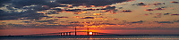 Panorama of the Sun rising under the Sunshine Skyway bridge from Fort De Soto Park in Pinellas County, Florida. Composite of five images taken with a Fuji X-T2 camera and 100-400 mm OIS lens (ISO 200, 100 mm, f/4.5, 1/250 sec).