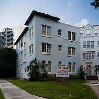 New highrise condos loom over a 1930s vintage appartment building at Biscayne Blvd. and NE 33rd St.  Image from a series called Paradise Lost, the changing face of Miami.