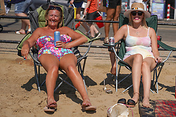 © Licensed to London News Pictures. 31/07/2020. Scarborough, UK. Carol Addey and Rebecca Addey pose for a picture during the hottest day of the year on Scarborough beach this afternoon. Sun-seekers flock to the seafront in Scarborough as temperatures are expected to reach 30 degrees Celsius in England. Photo credit: Ioannis Alexopoulos/LNP