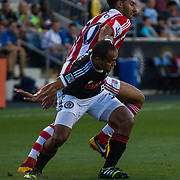 Stoke City F.C. Defender RYAN SHOTTON (30) battles Philadelphia Union Defender FABIO ALVES (33) for positioning in the first half a MLS regular season international friendly match between the Philadelphia Union and Stoke City F.C. Tuesday, July. 30, 2013 at PPL Park in Chester PA.