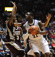 "Mississippi's Murphy Holloway (31) drives against Mississippi State's Brian Bryant (22) at the C.M. ""Tad"" Smith Coliseum in Oxford, Miss. on Wednesday, January 18, 2012. Mississippi won 75-68. (AP Photo/Oxford Eagle, Bruce Newman)."