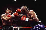 9 Nov 1996:  Mike Tyson, left, is hit by Evander Holyfield during their WBA Heavyweight Championship at the MGM Grand in Las Vegas, NV. Holyfield stopped Tyson in the 11th round to win the match..Mandatory Credit:  Icon Sports Media