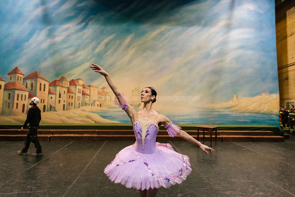 PALERMO, ITALY - 18 FEBRUARY 2018: Ballerina Annalisa Bardo, who interprets the role of the Queen of the Dryads in &quot;Don Quixote&quot;, rehearses backstage during the interval of the dress rehearsal at the Teatro Massimo in Palermo, Italy, on February 18th 2018.<br /> <br /> The Teatro Massimo Vittorio Emanuele is an opera house and opera company located  in Palermo, Sicily. It was dedicated to King Victor Emanuel II. It is the biggest in Italy, and one of the largest of Europe (the third after the Op&eacute;ra National de Paris and the K. K. Hof-Opernhaus in Vienna), renowned for its perfect acoustics. It was inaugurated in 1897.