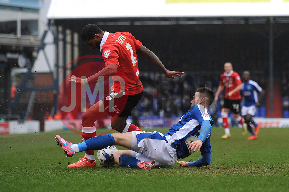 Bristol City's Mark Little is tackled by Oldham Athletic's William Gros - Photo mandatory by-line: Dougie Allward/JMP - Mobile: 07966 386802 - 03/04/2015 - SPORT - Football - Oldham - Boundary Park - Bristol City v Oldham Athletic - Sky Bet League One