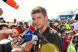 15.07.2014, Flughafen, München, GER, FIFA WM, Empfang der Weltmeister in Deutschland, Finale, im Bild Thomas Mueller #13 (Deutschland) beim Interview // during Celebration of Team Germany for Champion of the FIFA Worldcup Brazil 2014 at the Flughafen in München, Germany on 2014/07/15. EXPA Pictures © 2014, PhotoCredit: EXPA/ Eibner-Pressefoto/ Kolbert<br /> <br /> *****ATTENTION - OUT of GER*****