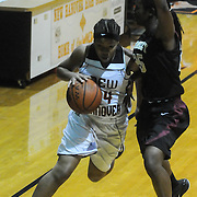New Hanover's Tanasia Tooner drives around Ashley's Jada Bacchus Friday December 19, 2014 at New Hanover High School in Wilmington, N.C. (Jason A. Frizzelle)