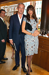 ANTON BILTON and LISA B at a reception in aid of Brooke Hospital for Animals held at Montes, Sloane Street, London SW1 on 22nd June 2004.