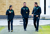18/08/15<br /> CELTIC TRAINING<br /> LENNOXTOWN<br /> Celtic manager Ronny Deila (centre) makes his way on to the training pitch alongside assistant John Collins and coach John Kennedy (right)
