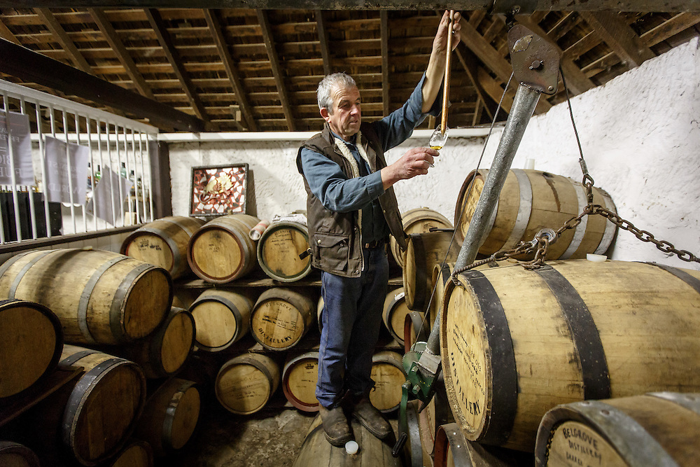 Distillery owner Peter Bignell inspects whisky inside the bond store at Belgrove Distillery in Kempton, Tasmania, August 25, 2015. The entire distillery is a former stable sub-divided into four sections: still, mashing, tasting room, and bond store. Gary He/DRAMBOX MEDIA LIBRARY