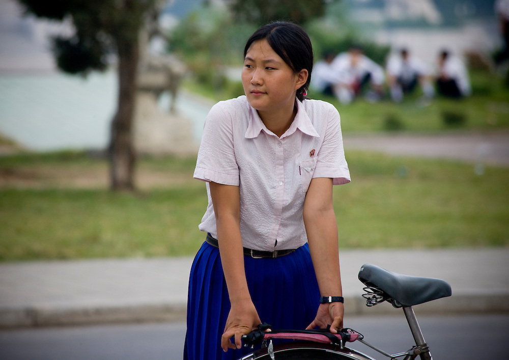 -Why don't women cycle in Pyonggyang?<br /> -Because it is dangerous and it doesn't give you nice legs.<br /> -Then why all women in the countryside do cycle?<br /> -They don't have much of a choice in the countryside...<br /> <br /> North Korean girl, North Korea.