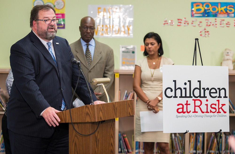 Bob Sanborn of Children at Risk comments during a news conference discussing back to school parenting at Cunningham Elementary School, September 3, 2015.