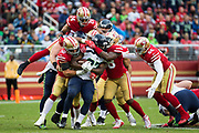 The San Francisco 49ers defense stops Seattle Seahawks running back Eddie Lacy (27) during a carry at Levi's Stadium in Santa Clara, Calif., on November 26, 2017. (Stan Olszewski/Special to S.F. Examiner)