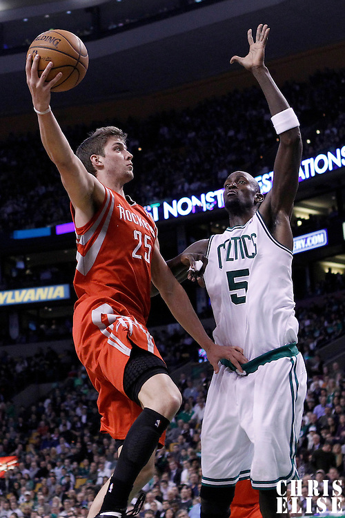 06 March 2012: Houston Rockets forward Chandler Parsons (25) goes for the layup against Boston Celtics power forward Kevin Garnett (5) during the Boston Celtics 97-92 (OT) victory over the Houston Rockets at the TD Garden, Boston, Massachusetts, USA.