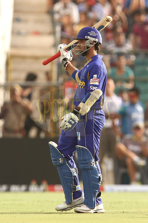 Ajinkya Rahane of the Rajasthan Royals raises his bat after reaching his fifty during match 60 of the the Indian Premier League (IPL) 2012  between The Rajasthan Royals and the Pune Warriors India  held at the Sawai Mansingh Stadium in Jaipur on the 13th May2012..Photo by Shaun Roy/IPL/SPORTZPICS