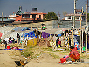 04 MARCH 2017 - KATHMANDU, NEPAL: People do their laundry in an IDP camp in the center of Kathmandu. The camp opened days after the April 2015 earthquake devastated Nepal, killing almost 9,000 people. At its peak, about 1,800 families lived in the camp. The camp is still open nearly two years after the earthquake, about 400 families currently live in the camp. Camp residents say the Kathmandu municipal government is trying to close the camp and is encouraging residents to find new housing. They said the government is cutting off services to the camp and last week stopped the free distribution of water, although water can be purchased for delivery. Most of the people in the camp came to Kathmandu from rural villages in the mountains in the weeks after the earthquake. Many of the residents of the camp, technically homeless, have found work in Kathmandu's bustling construction industry, rebuilding homes destroyed in the earthquake.       PHOTO BY JACK KURTZ
