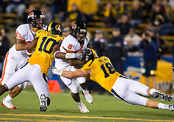 November 7, 2009; Berkeley, CA, USA;  Oregon State Beavers wide receiver James Rodgers (8) is tackled by California Golden Bears linebacker Michael Mohamed (18) during the third quarter at Memorial Stadium.