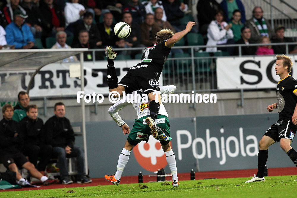 2.9.2012, Wiklof Holding Arena, Mariehamn / Maarianhamina..Veikkausliiga 2012..IFK Mariehamn - Kuopion Palloseura..Ermin Gadzo (IFK Mhamn) v Markus Joenm?ki (KuPS).
