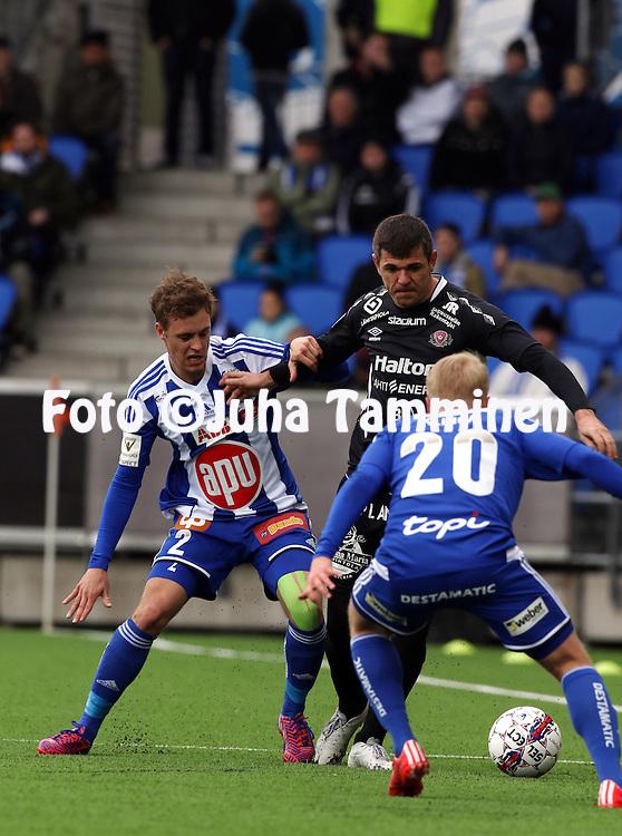 19.4.2015, Sonera stadion, Helsinki.<br /> Veikkausliiga 2015.<br /> Helsingin Jalkapalloklubi - FC Lahti..<br /> Alex Lehtinen &amp; Matti Klinga (HJK) v Rafael (FC Lahti).