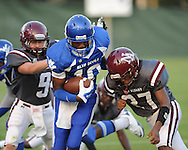 Water Valley's L.J. Hawkins (10) vs. New Albany's Mikey Wood (9) and Eddie Barry (27) at Bobby Clark Field in Water Valley, Miss. on Friday, August 22, 2014. Water Valley won the season opener 36-33.