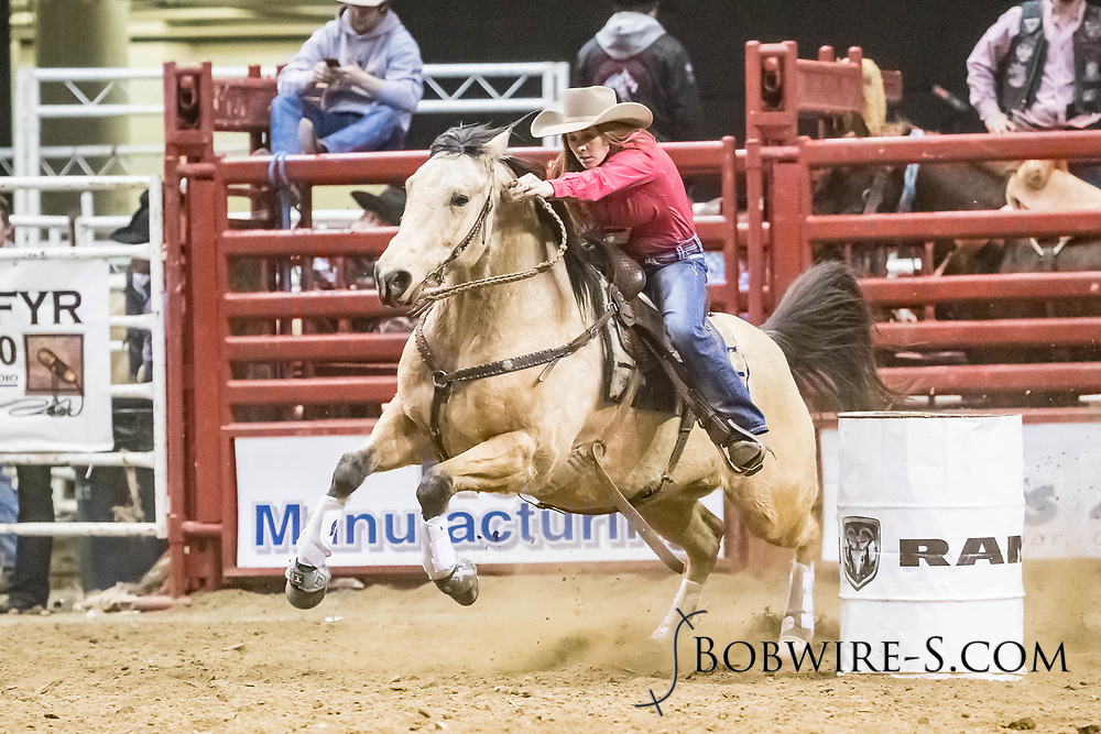 Lindsey Horner makes her barrel run at the Bismarck Rodeo on Friday, Feb. 2, 2018. She ran a 13.77.