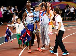 Great Britain's Mo Farah celebrates with his children Amani Farah, Aisha Farah, Rhianna Farah, Hussein Mo Farah after winning the Men's 10,000m during day one of the 2017 IAAF World Championships at the London Stadium.