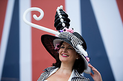 © London News Pictures. 20/06/2013. Ascot, UK.  Natalie Haverstock wearing  hat made from balloons at Ladies Day on day three of Royal Ascot at Ascot racecourse in Berkshire, on June 20, 2013.  The 5 day showcase event,  which is one of the highlights of the racing calendar, has been held at the famous Berkshire course since 1711 and tradition is a hallmark of the meeting. Top hats and tails remain compulsory in parts of the course. Photo credit should read: Ben Cawthra/LNP