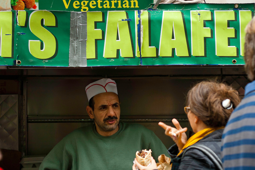 A Vegetarian Falafel vendor chats with a customer in Zuccotti Park while the Occupy Wall Street gathering is in progress. October 21, 2011.