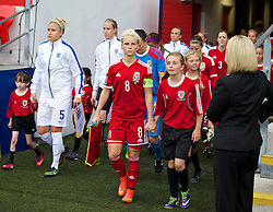 CARDIFF, WALES - Tuesday, August 21, 2014: Wales' captain Jessica Fishlock leads her side out to face England during the FIFA Women's World Cup Canada 2015 Qualifying Group 6 match at the Cardiff City Stadium. (Pic by David Rawcliffe/Propaganda)