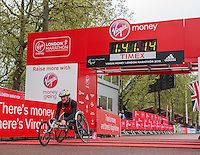 Tatyana Mcfadden of the USA crosses the line to win the Elite Womens wheelchair race at the Virgin Money London Marathon, Sunday 26th April 2015.<br /> <br /> Scott Heavey for Virgin Money London Marathon<br /> <br /> For more information please contact Penny Dain at pennyd@london-marathon.co.uk